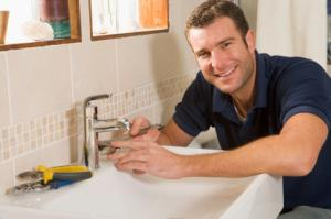 A Member of Our Poway Plumbing Team Installs an Aerator on a Bathroom Faucet